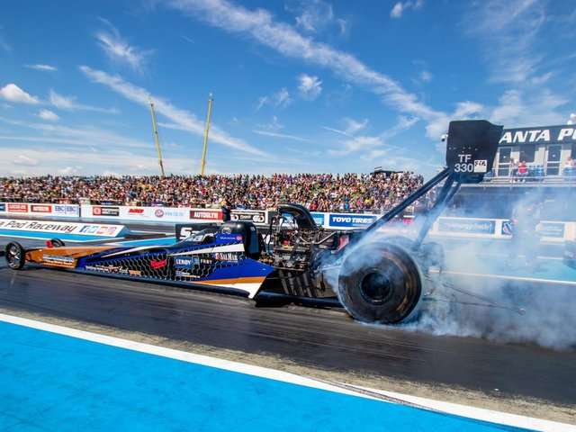 10,000-horsepower Top Fuel Dragster action is featured on the 2021 calendar at Santa Pod Raceway. Pictures courtesy of Santa Pod