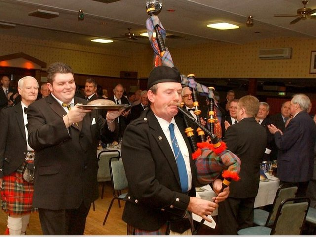 The haggis being piped in at The Grampian's 2003 Burns Night. Pictured are Ian McLean, clue steward Ali McLeod and piper Michael Murray