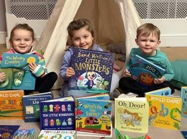 Children with some of the donated books.