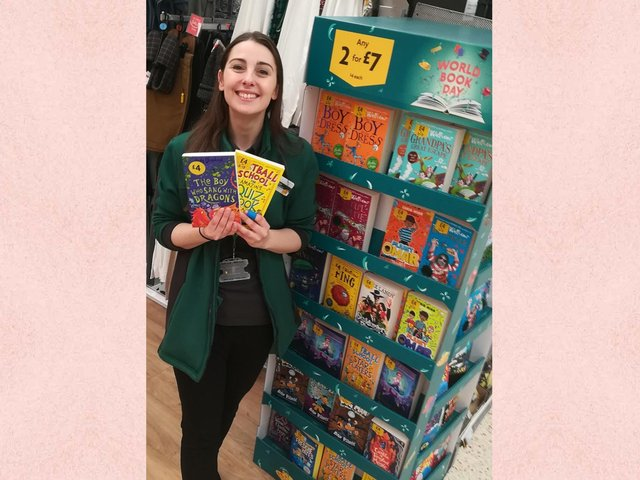 Skye Summerton with some of the books