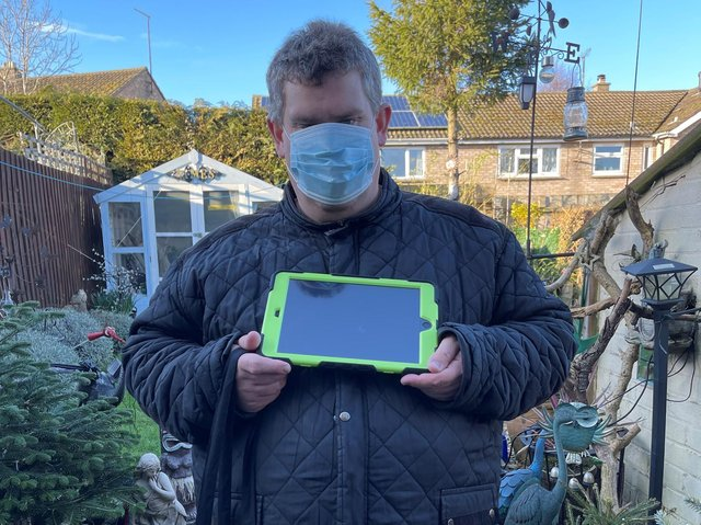 James, a Teamwork Trust service-user with his new digital device