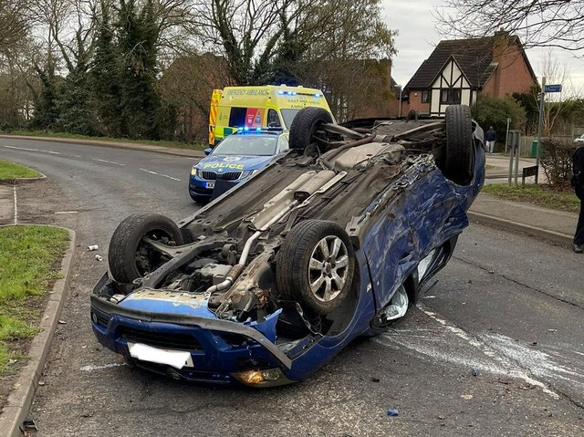The Vectra wound up on its roof after the smash in Hardwick Road, Wellingborough, early on Saturday morning. Photos: @Northants_RCT