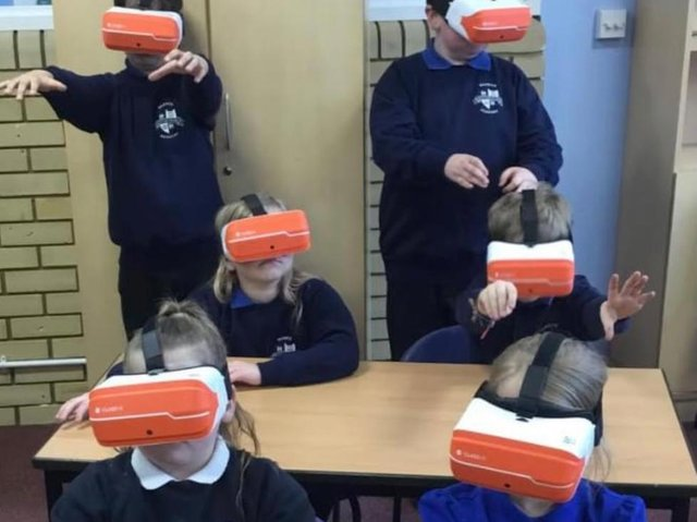 Children from Warwick Primary School experience the VR headsets