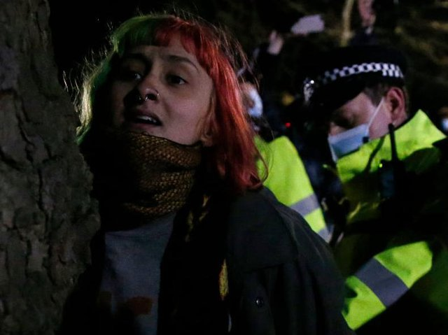 A woman is arrested during Saturday night's vigil for murdered Sarah Everard. Photo Getty Images