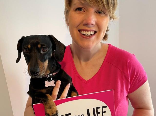 Cancer survivor Heather Duff with her miniature dachshund Parsnip