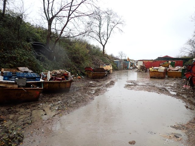 The illegal waste site.