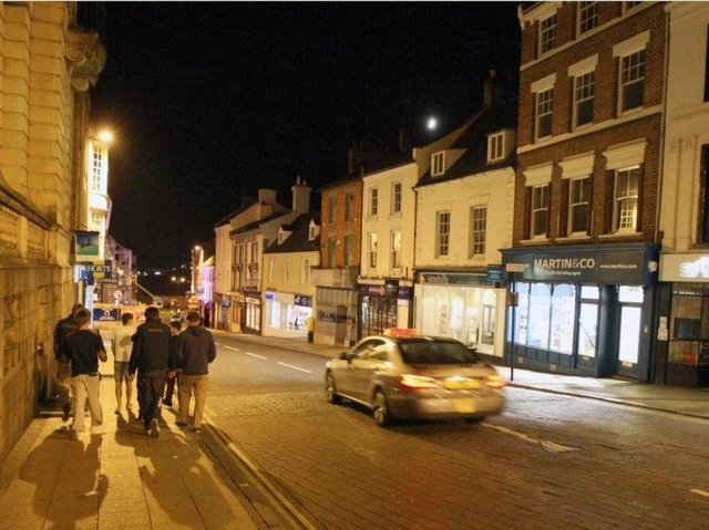 Four young men beat a man unconscious in Northampton town centre in a drunken group attack.