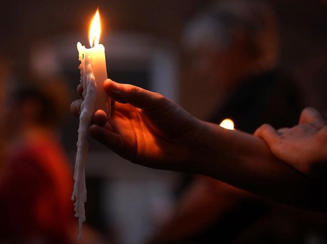 People are being urged to light a candle and stand on their doorsteps at 8pm tonight . Photo: Getty Images