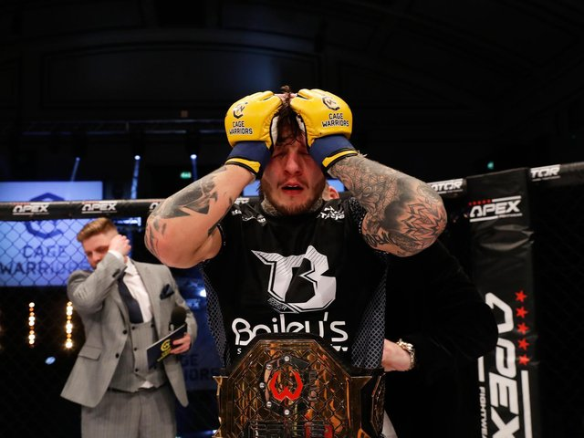 Emotions were running high for Jordan Vucenic after he won the Cage Warriors featherweight title. Pictures courtesy of Dolly Clew (www.dollyclew.com)