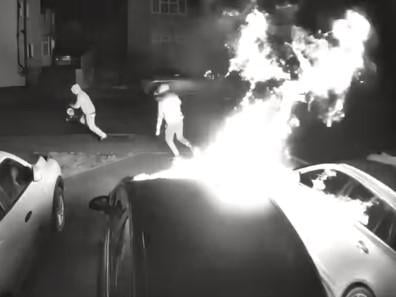 Security cameras caught the two yobs setting light to cars on a Weedon driveway at 1.49am on Tuesday morning