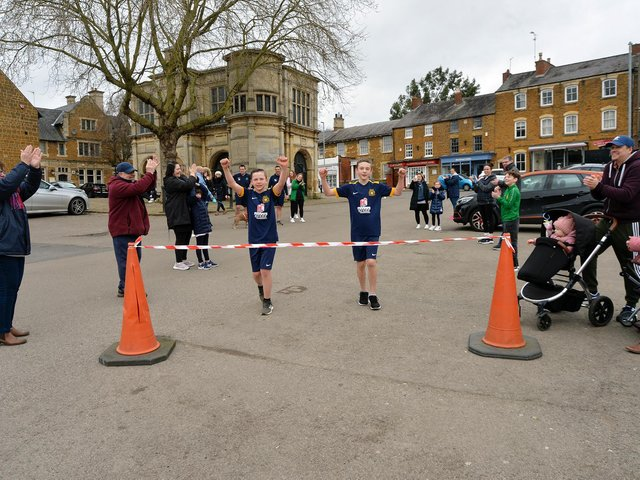 Charlie (left) and Harry (right) finishing the first half-marathon. Picture: Andrew Carpenter