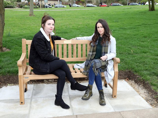 Claire and Lauren Holmes at the bench installed in memory of their big sister. Picture: Alison Bagley Photography.