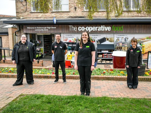 Store Manager Rebecca Wilkinson (front, centre) with colleagues outside the refreshed High Street Central England Co-op store.