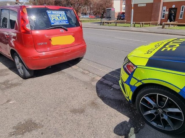 A vehicle was seized after a woman was reported for driving without a licence or insurance in Kettering