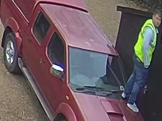 CCTV cameras caught the thief standing on the Nissan truck before smashing a window to roll it out of the way. Photo: Northamptonshire Police