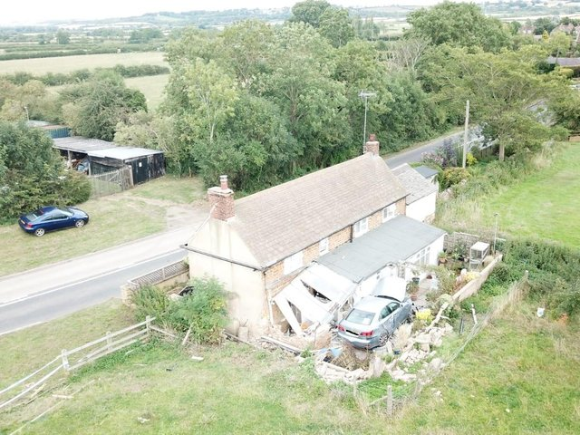 The cottage and the car that crashed into the home was wedged for four months