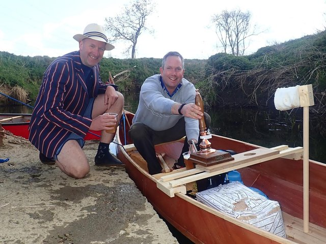 L-r Giles Darby and Jon Wells with the canoe complete with beer pump