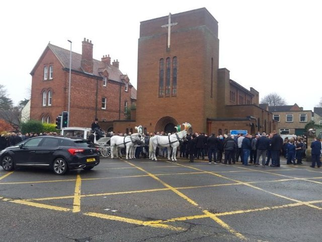 Mourners outside the funeral last year.