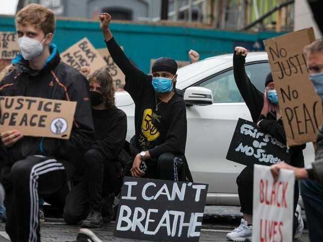 Protesters at the Black Lives Matter march in Northampton in May last year. 'I Can't Breathe' comes from the footage of George Floyd's murder as white police officer knelt on his neck for over nine minutes. Photo: Leila Coker
