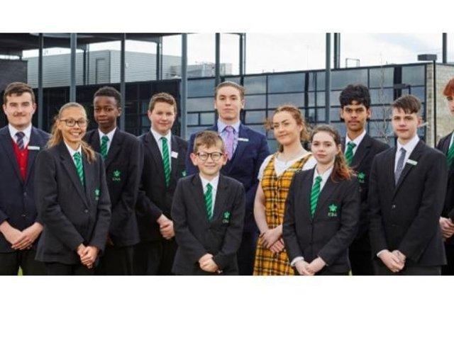 Staff and pupils at Corby Business Academy.