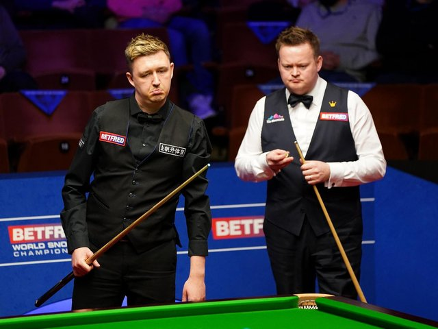 Kettering's Kyren Wilson holds a 6-2 lead over Shaun Murphy, who grew up in Irthlingborough, going into the second session of their World Championship semi-final this afternoon. Picture courtesy of Getty Images