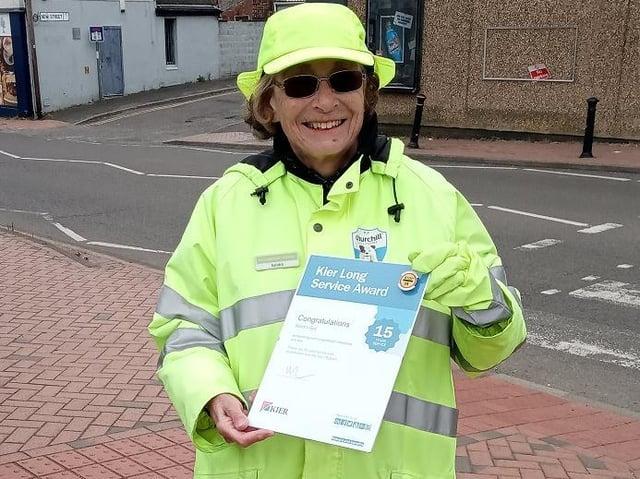 Sandra Guy with her long service award