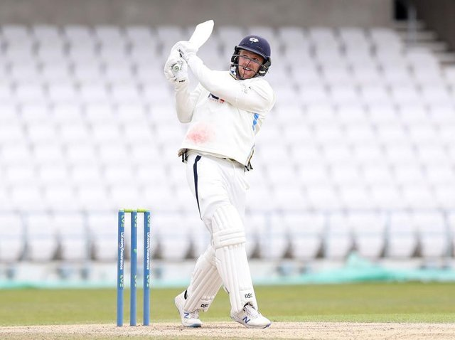 David Willey hits out on his way to a crucial 41 not out for Yorkshire