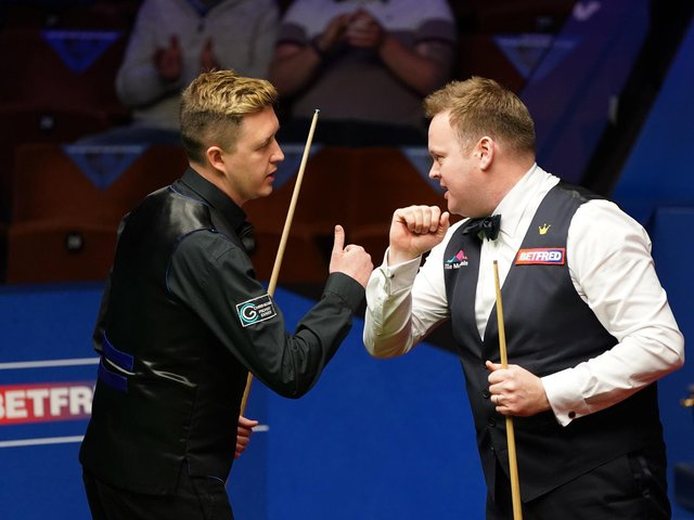 Kettering's Kyren Wilson congratulates former Irthlingborough man Shaun Murphy after the latter fought back to win 17-12 in their World Championship semi-final clash at the Crucible. Picture courtesy of Getty Images