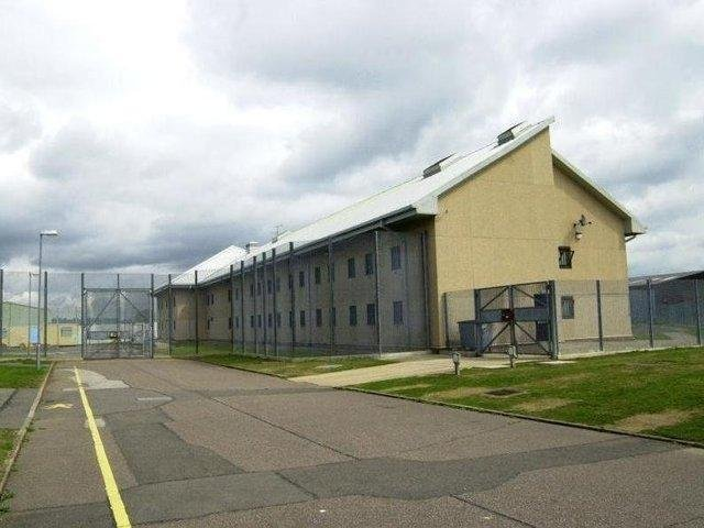 A prisoner of HMP Onley assaulted four members of staff for trying to move him to another wing.