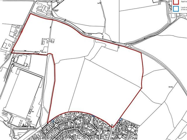 The development site, outlined in red.