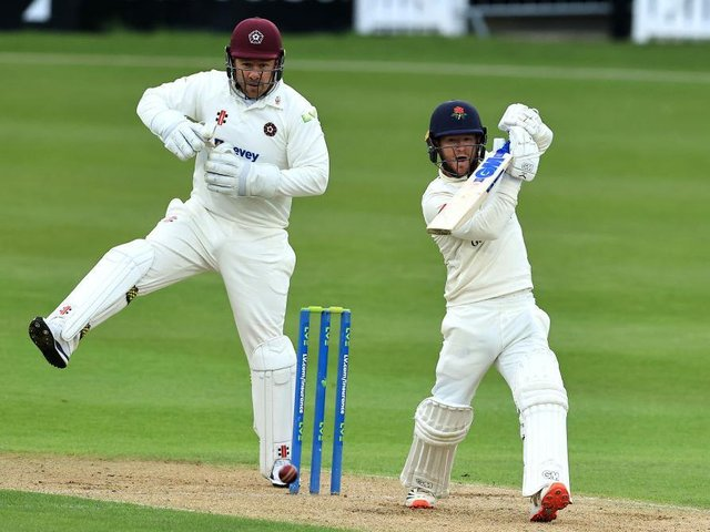 Alex Davies tries to force a shot off the bowling of Tom Taylor