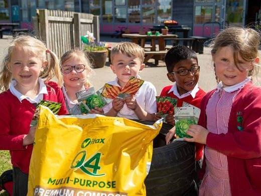 Students at Oakley Vale Primary School with the seeds and compost donated by Barratt Homes