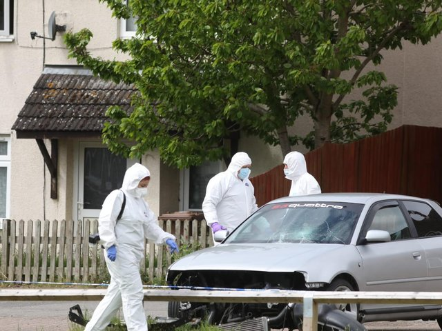 Forensics officers at the scene.