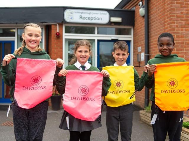 Irthlingborough Junior School pupils with the donated hi-vis bags
