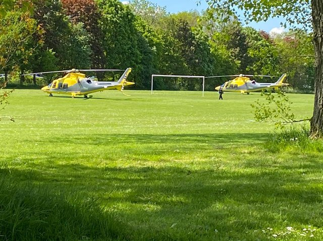 Two air ambulances are on the scene at Abington Park
