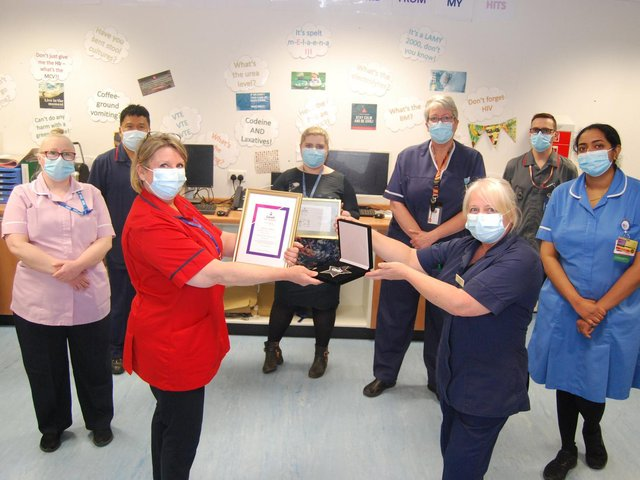 The Digestive Diseases Unit team are presented with their award by Head of Clinical Operations Jo Sturgess (L) to DDU Ward Sister Angie Robinson.