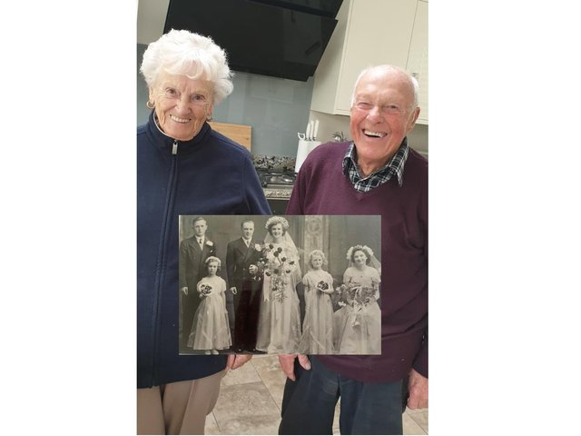 Betty and John with their original wedding photo