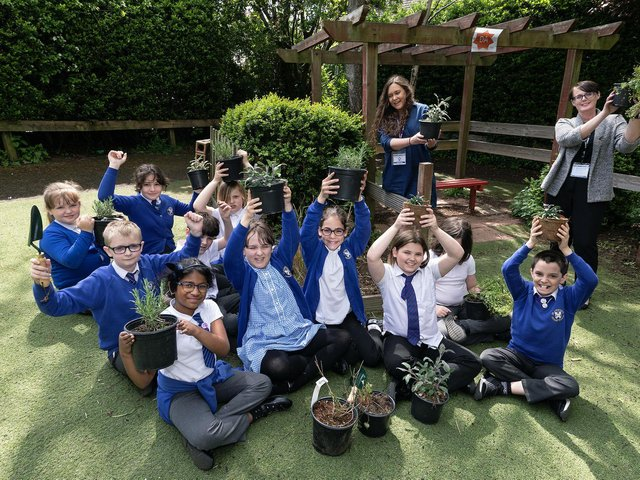 Pupils from St Andrew's Primary with Yvette Christy from Tilia Homes