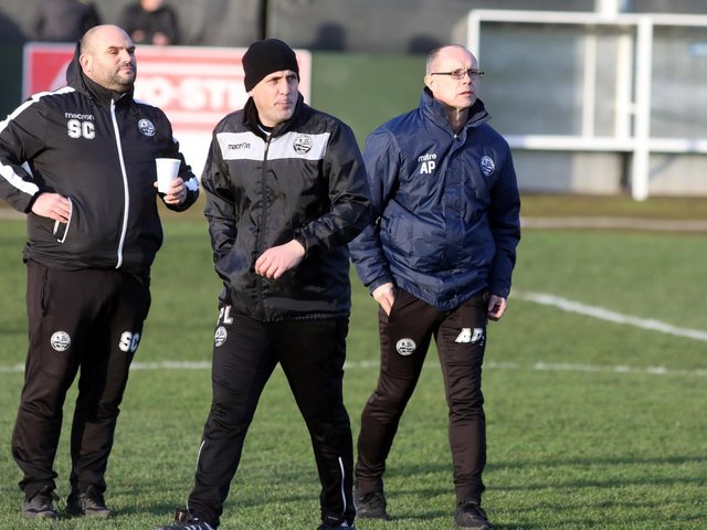 Paul Lamb (centre), who was previously assistant-manager at AFC Rushden & Diamonds alongside Andy Peaks, has been appointed as the new boss of Wellingborough Town