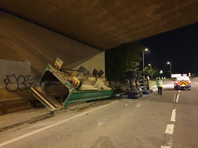 A lorry overturned after hitting Wooldale Road Bridge in the early hours of this morning.