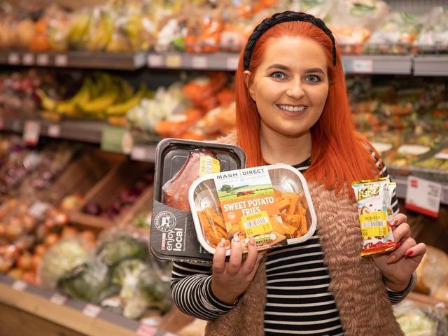 Shopper Seana McRory takes advantage of the Gander app.