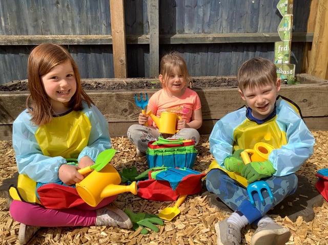 Children at Crazy4Kids nursery in Thrapston with their gardening equipment donated by David Wilson Homes