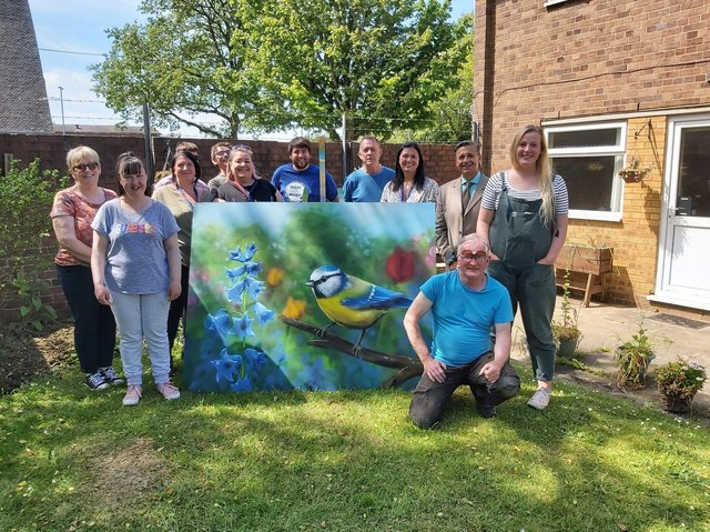 The team at Mind Corby with one of the wildlife panels