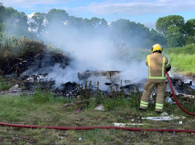 Firefighters had to hose down a pile of burning waste two times in one evening.