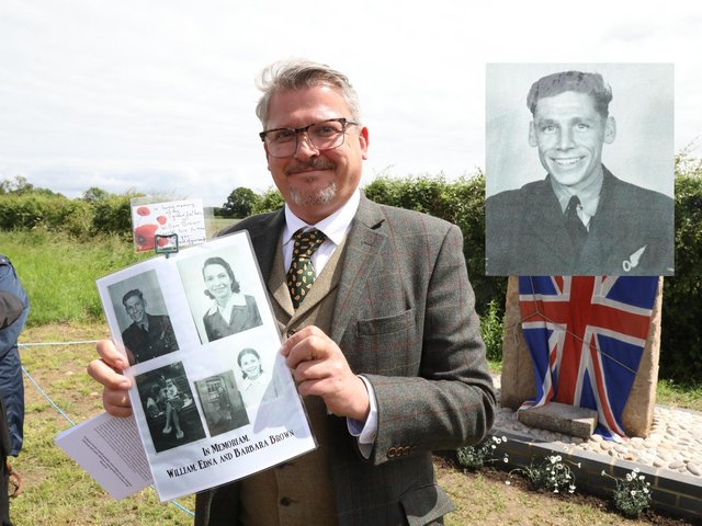 James Pogson with a photo of his grandfather Flight Sergeant William Brown DSO