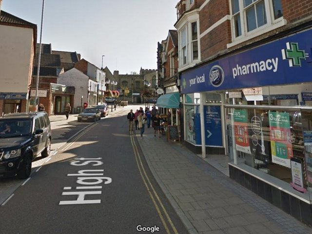 Police are hunting three masked men who stole a wallet near Boots in Rushden town centre on Friday