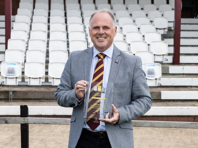 Ray Payne with his 'business hero' award.