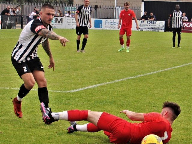 Callum Westwood in action during Corby Town's 4-2 friendly win over Melton Town at Steel Park. Pictures by David Tilley