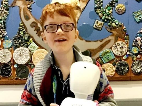 Alexanda Harvey, 13, with his AV1 robot.