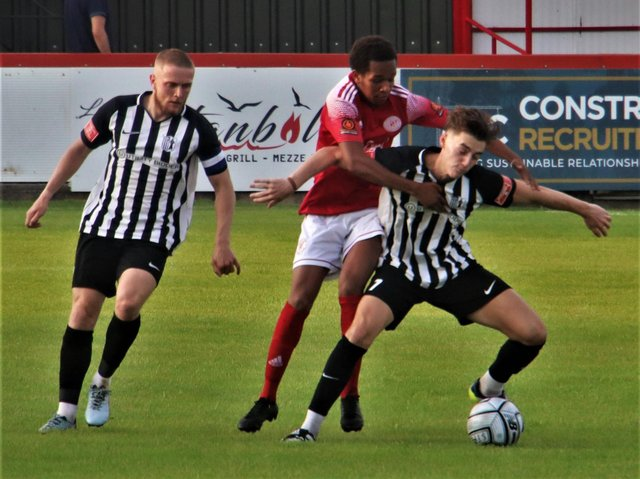 Action from Corby Town's 4-1 defeat at Brackley Town. Picture by David Tilley